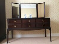Stag Minstrel Bedroom suite Dressing table chest of drawers, headboard, double and triple wardrobes.