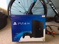 PLAYSTATION4 PRO JETBLACK 1TB BRAND NEW CONDITION WITH DUALSHOCK CONTROLLER THREE GAMES AND RECEIPT