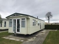 Beautiful glazed and heated caravan with front opening patio doors for sale on stunning park.