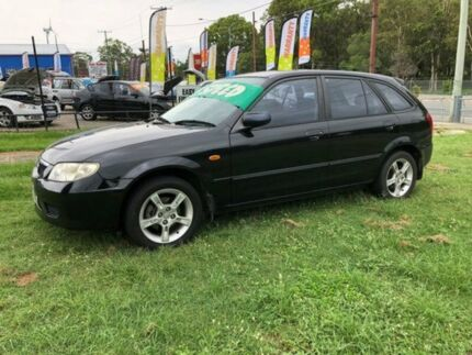 2003 Mazda 323 Astina Black 5 Speed Manual Hatchback Clontarf Redcliffe Area Preview