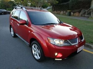 2009 Mitsubishi Outlander ZG MY09 LS (7 Seat) Red Metallic 6 Speed CVT Auto Sequential Wagon Chermside Brisbane North East Preview