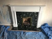 White painted wooden fire surround with black and white marble insert and hearth for sale.
