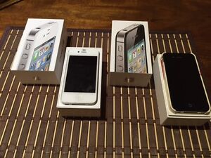 Two iPhone 4s phones and docking station