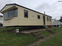 low priced doubleglazed/heated &Imaculate.This caravan is on a low end site fees at Devon Cliffs