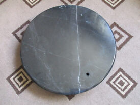Large round slab black marble