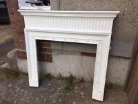 Fibreglass fireplace surround with marble/marble effect (not sure which) tiles.