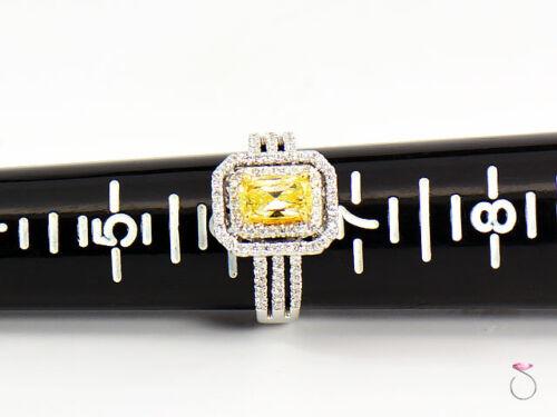 Natural Fancy Intense Yellow Diamond Ring, 1.02 ct. 18K White Gold 1.40 CTW. GIA 9