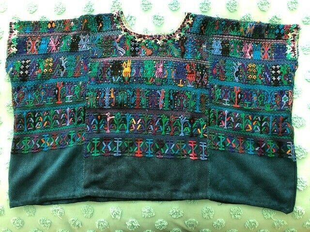 Exquisite hand embroidered, hand-woven huipil from Santa Catarina Palopo