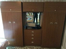 Double wardrobe with mirrored vanity section in the middle & Storage above