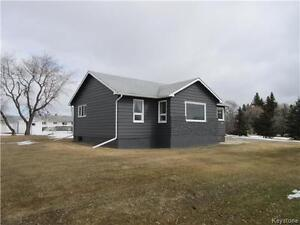3 BR home on a large lot with a private setting in Strathclair M