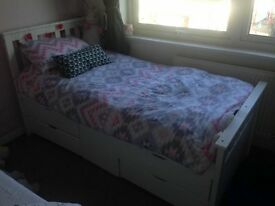 White wooden bed with 4 drawers and middle compartment
