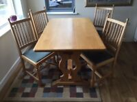 Solid as dining table and 4 upholstered chairs.