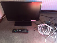 23 inch flat screen Logik tv with stand, remote control, aerial cable and booster