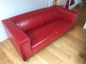 Red leather IKEA 'Klippan' sofa, good condition (covered most of its life)