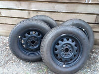 Four Uniroyal Tiger Paw - 175/70r13 820 winter tires on rims.