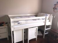 Single bunk bed with desk and storage area