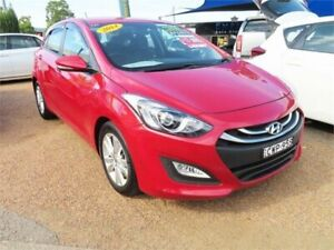 2014 Hyundai i30 GD2 SE Hatchback 5dr Spts Auto 6sp 1.6DT [MY14] Red Sports Automatic Hatchback Minchinbury Blacktown Area Preview