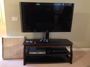 "TV media stand and 55"" Samsung TV and PVR and DVD player"