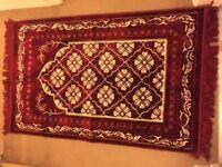 small red carpet. brand new. dark red and cream colour