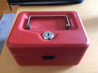 small metal cash box, red