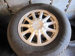 215/70/15 FORD RIMS AND TIRES, LOTS OF TREAD GREAT SHAPE