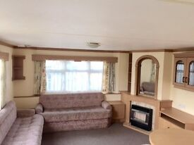 Cheap D/G 12ft wide caravan on East Sussex coastline,dog friendly,fishing lake not Coghurst,Hastings