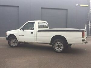 1990 Holden Rodeo TF Deluxe Cab Chassis 2dr Man 5sp 4x4 2.6i White Manual Cab Chassis
