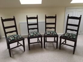 Set of 4 antique carved oak ladderback dining chairs with embroidered seats