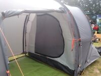 Grey 4 person tent. 2 sleeping compartments. Central area. Folds small into bag. Used only twice