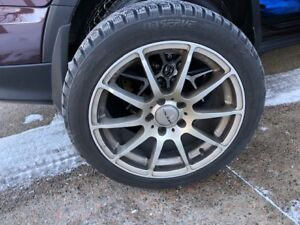 PRICE REDUCED> Custom really nice aluminum rims and winter tires