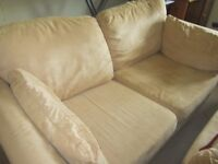 Sofa works settee, sits 3 people. Suede type covering in a warm beige colour.