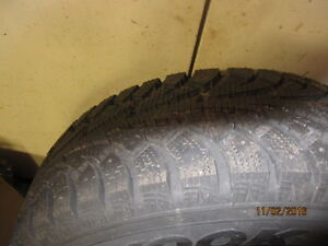 4 Hankook tires on steel rims c/w storage rack London Ontario image 4