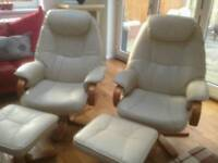 Leekes cream leather reclining chairs with matching footstools