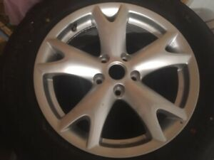 NEW Nissan Rogue OEM rim and tire never used