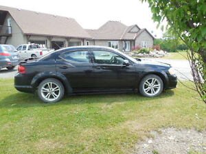 2012 Black Dodge Avenger for Sale – 125,625 kms.