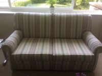 2 Seater Sofa in gentle stripes, soft colours, very good condition, rarely used.