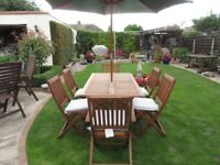 Garden table and chairs ,PLUS ,PARASOL,CUSHIONS, EXCELLENT CONDITION