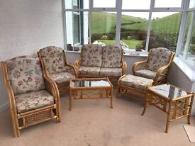 7 piece Cane Conservatory Furniture: sofa, table, chairs stool