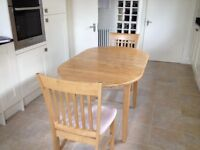 Kitchen expandable table and two chairs.