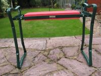 Kneeling stool. Removes the bending position when gardening