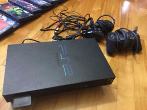 PLAYSTATION 2 WITH GAMES (PRICE IS NEGOTIABLE)