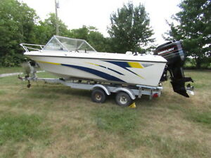 17 ft boat and tandem aluminum trailer Motor sold