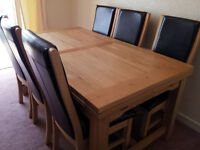 Beautiful solid oak dining table and 8 chairs