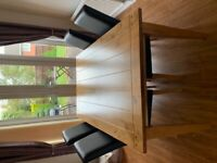 Oak dining table and four leather chairs
