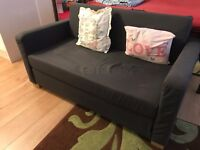 Very good condition two seater sofa with convertable bed mattress only used by single person