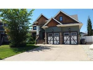 Former S.T.A.R.S Falcon Show Home in Sylvan Lake, AB
