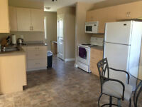 Vacation Rental w/full kitchen in Exec Home near lakes and beach