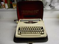 Portable Typewriter made by Imperial - with case