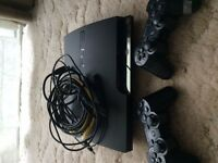 PS3 and 2 controllers