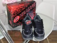 Brand new Healys roller boots/shoes black and red, boxed